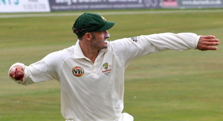 Mike Hussey plays out a maiden
