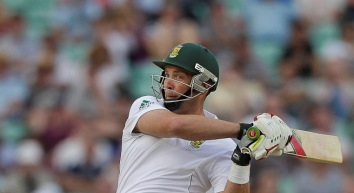 Jacques Kallis having recently hit a cricket ball using a cricket bat