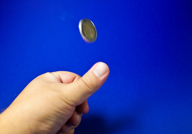 Coin tossing (CC licensed by Gerwin Sturm via Flickr)